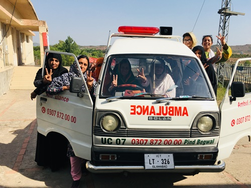 A picture of women standing around the meseeha ambulance